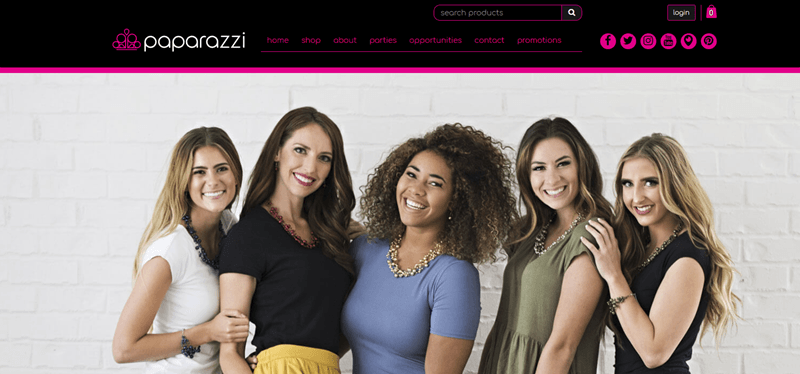 Paparazzi website screenshot showing an image of five girls standing in front of a white brick wall.