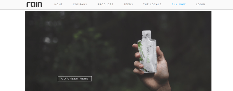 Rain website screenshot showing the blurred background of a forest with a hand holding one of the rain CORE sachets.