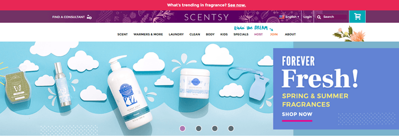 Scentsy website screenshot showing a selection of products against a crafted blue background.