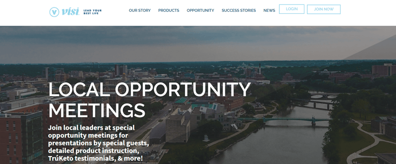 Visi website screenshot showing a high view of a city. This is overlaid with white text that talks about Local Opportunity Meetings.