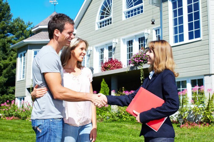 real estate agent showing a house to a young couple that discovered the property using her WordPress plugin