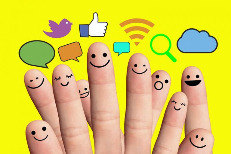 fingers with faces painted on and text bubbles to represent the best social sharing plugins for wordpress websites
