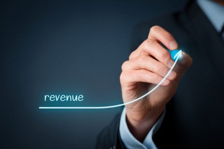hand drawing a line showing an increase in revenue from display ad earnings