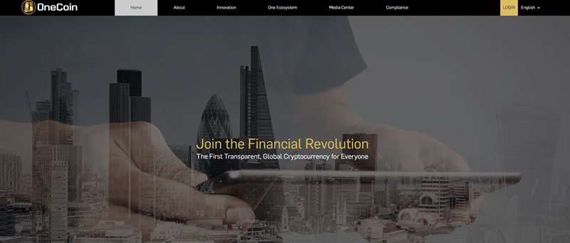 Onecoin website screenshot showing an image of a city, along with an image of a man holding a tablet.