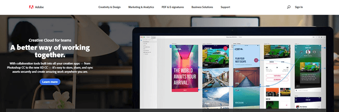 Adobe website screenshot showing the background image of an office, with a foreground image of Adobe software on a computer monitor.