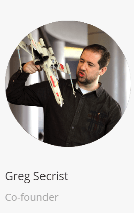 "This is a screenshot from the ""About Us"" page of BKA Content. The image of the cofounder Greg Secrist holding an X-Wing fighter is seen after mousing his more professional picture."
