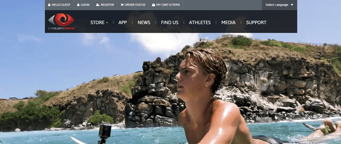 Cyclops Gear website screenshot showing a young man on a surfboard with cliffs and sky in the background.