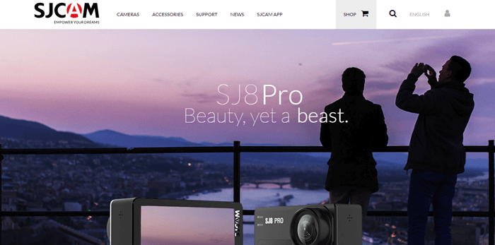 SJCAM website screenshot showing two people standing on a balcony overlooking a city at the end of the day.