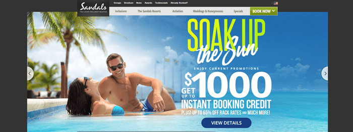 Sandals Resorts website screenshot showing a young couple lying in a clear blue sea and grinning, with palm trees in the background.