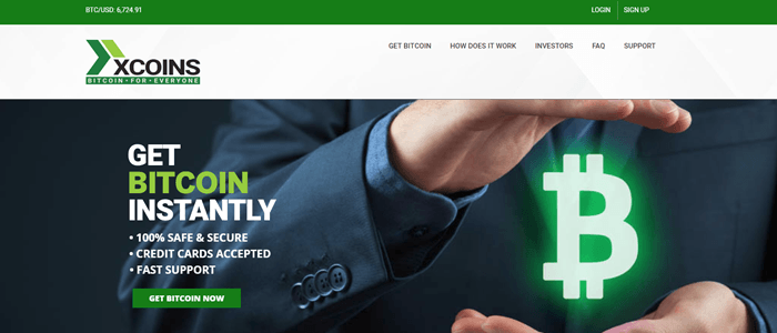 xCoins website screenshot showing a business man who appears to be holding a neon Bitcoin symbol between his hands.