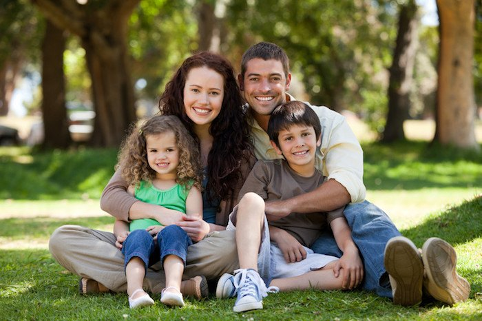 father, mother, and two young children in the park representing the best family affiliate programs