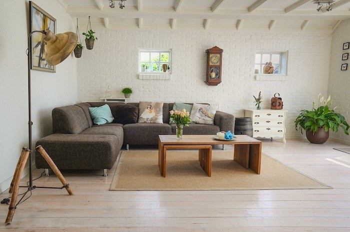 modern living room with brown couch and other furniture representing the best home decor affiliate programs