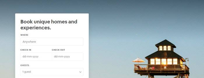 Airbnb website screenshot showing a freestanding loft-style house contrasted against the open sky.