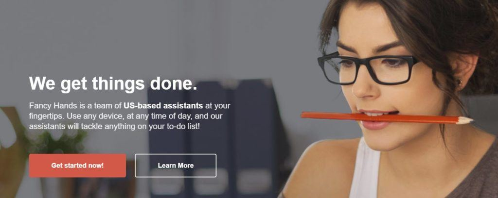 Fancy Hands website screenshot showing a young woman in glasses with a pencil between her teeth.