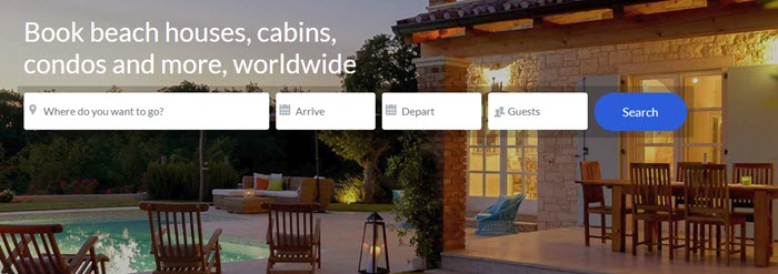 HomeAway website screenshot showing an image of a vacation home with a pool, plenty of outdoor chairs and lighting.