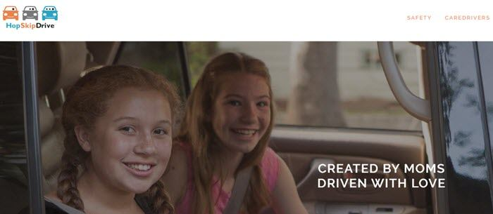 HopSkipDrive website screenshot showing two smiling young girls in the backseat of a car.
