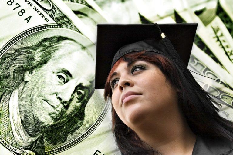 A young woman wearing a graduation cap with pictures of money in the background