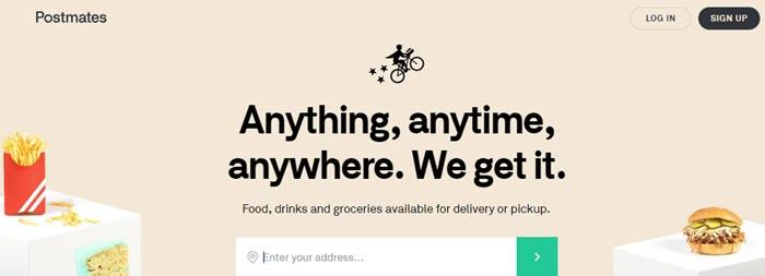Postmates website screenshot showing white cubes with food on them (fries, cake and a burger) against a beige background.