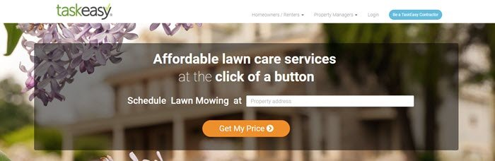 TaskEasy website screenshot showing an out of focus image of apartments with purple flowers, along with details about affordable lawn care services.