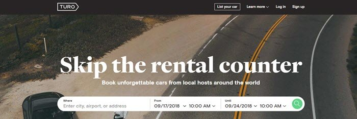 Turo website screenshot showing an overhead image of an open road with a man and a car.