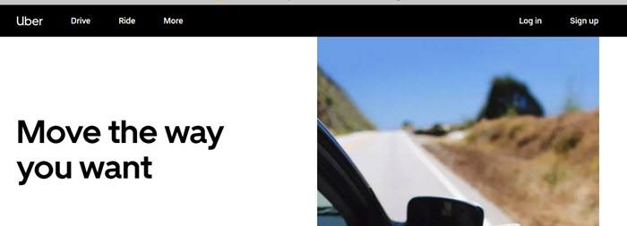 Uber website screenshot showing a small image of a car driving on an open road.
