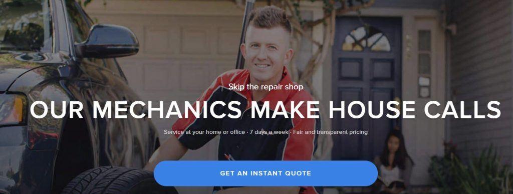 YourMechanic website screenshot showing a young mechanic changing a tire outside a woman's house.