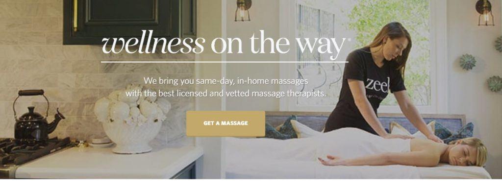 Zeel website screenshot showing a young woman in a Zeel shirt giving a blonde woman a back massage.