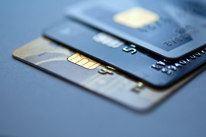 three dark-colored credit cards and their chips representing the best credit card affiliate programs