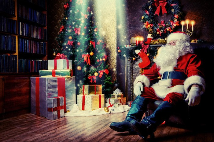 santa clause sitting on a chair looking exhausted with a pile of presents under the christmas tree representing best holiday gifts affiliate programs