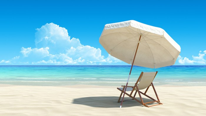 beach with chair and umbrella and blue sky representing the best tourism affiliate programs