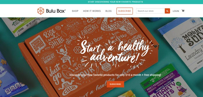 Bulu Box website screenshot showing the box surrounded by a few samples and snacks.