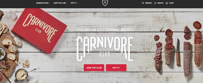 Carnivore Club website screenshot showing a white wooden background, the box and various cured meats.