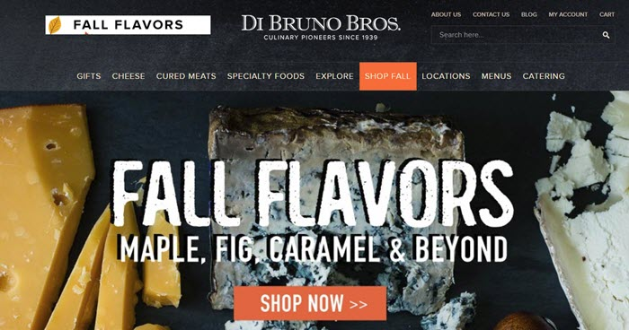 Di Bruno Bros website screenshot showing three cheeses on a dark background.