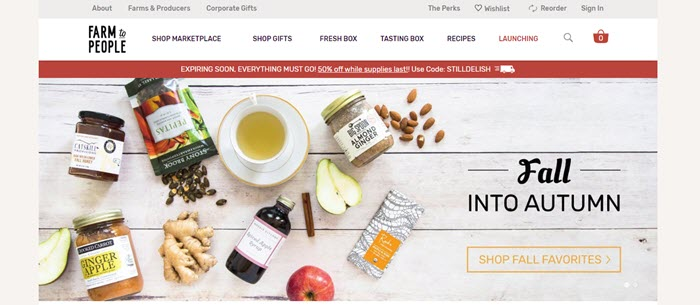 Farm to People website screenshot showing a selection of the products and some ingredients against a white wooden background.