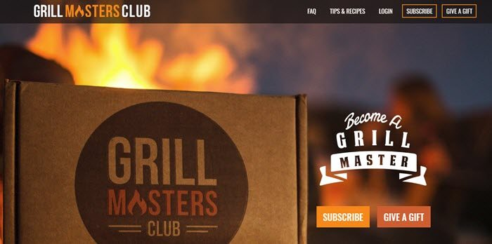 Grill Masters Club website screenshot showing a foreground image of the box with a fire of some type blurred out in the background.