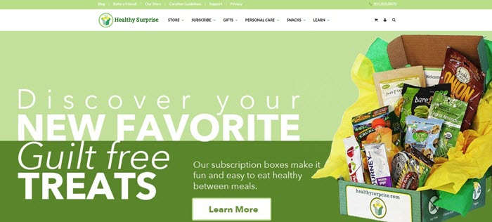 Healthy Surprise website screenshot showing one of their boxes and the various products, against a two-tone green background.