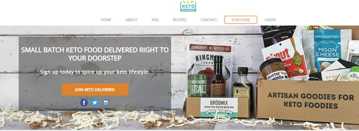 Keto Delivered website screenshot showing the box and selection of snacks on the ground against a white wooden wall.