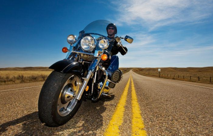 fish eye lens closeup of motorcycle and driver on the highway for the best motorcycle dirt bike affiliate programs
