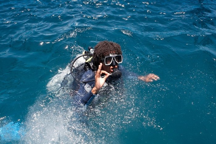 man scuba diving representing extreme water sports