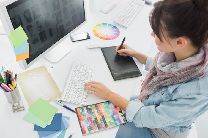 young woman working on a computer animation at an office