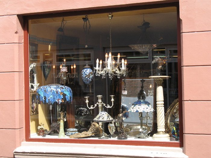 photo of antique shop with many items in the window