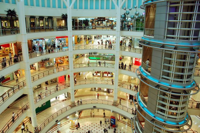 multi-story shopping mall with products being sold