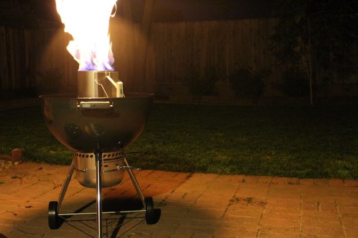 charcoal grill with large flames spewing out