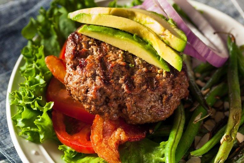 bun-less hamburger patty with avocado, bacon, tomato, and lettuce