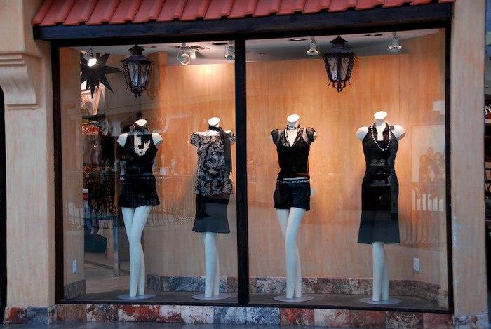 designer clothing sitting on mannequins at a boutique shop