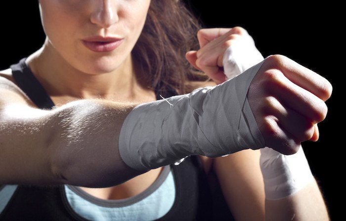 close up photo of a wrapped fist from a woman to represent the best self defense affiliate programs