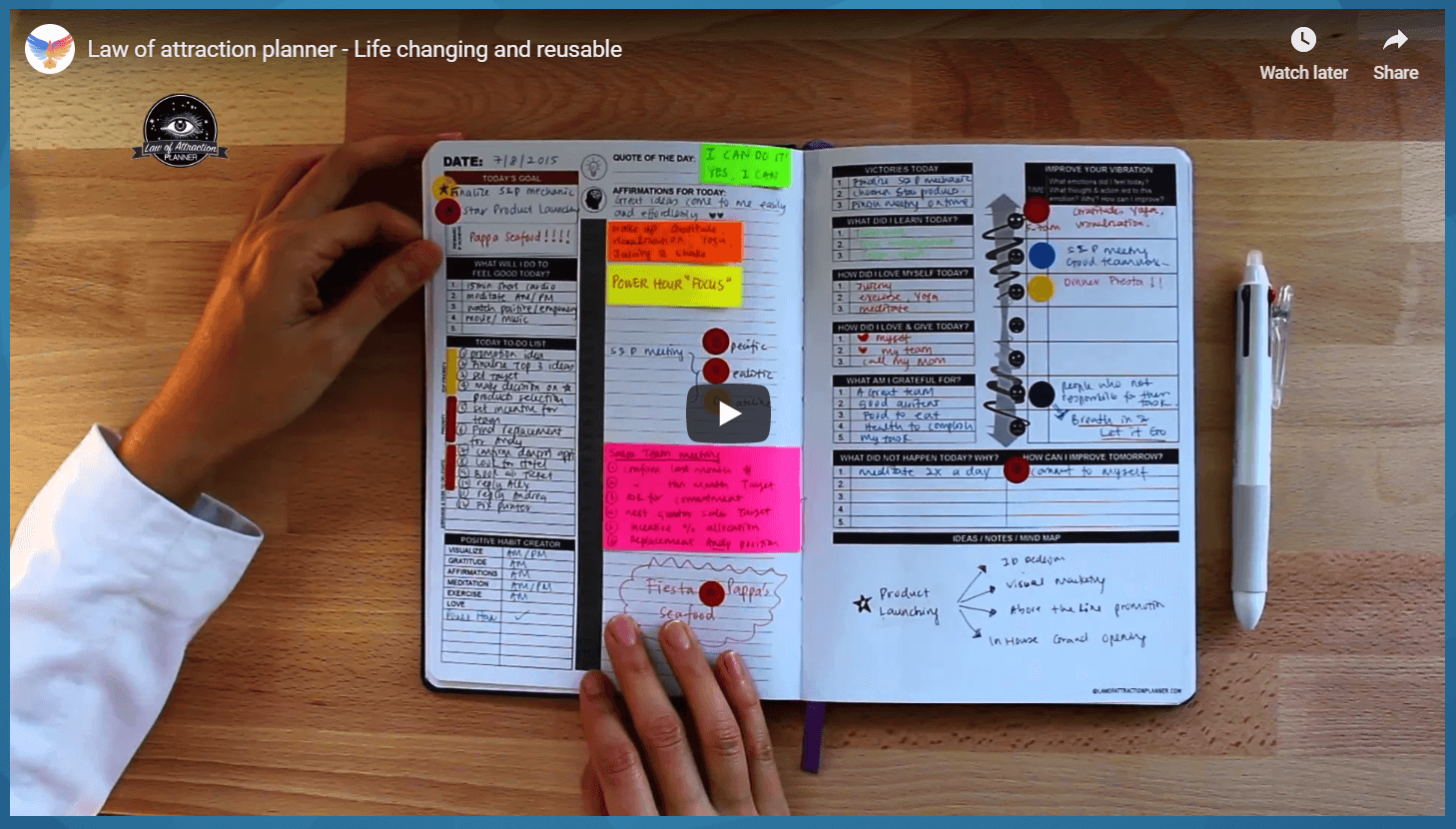 This photo shows a man's hands flipping through a colorful and well-organized Manifestation Planner.