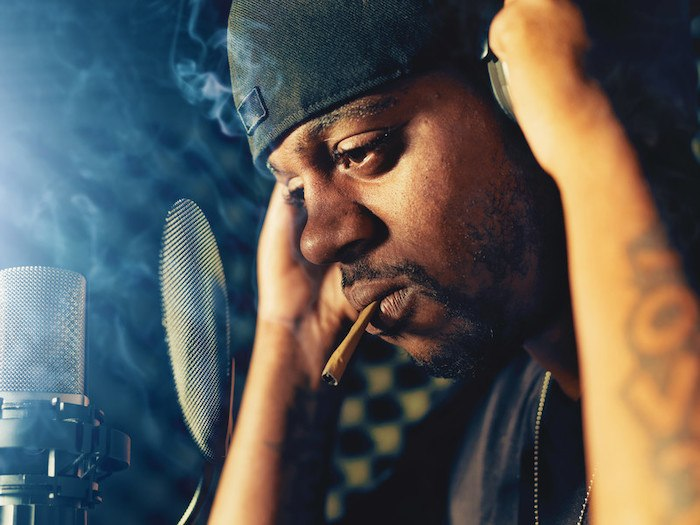 rapper with a joint representing the best hip hop affiliate programs