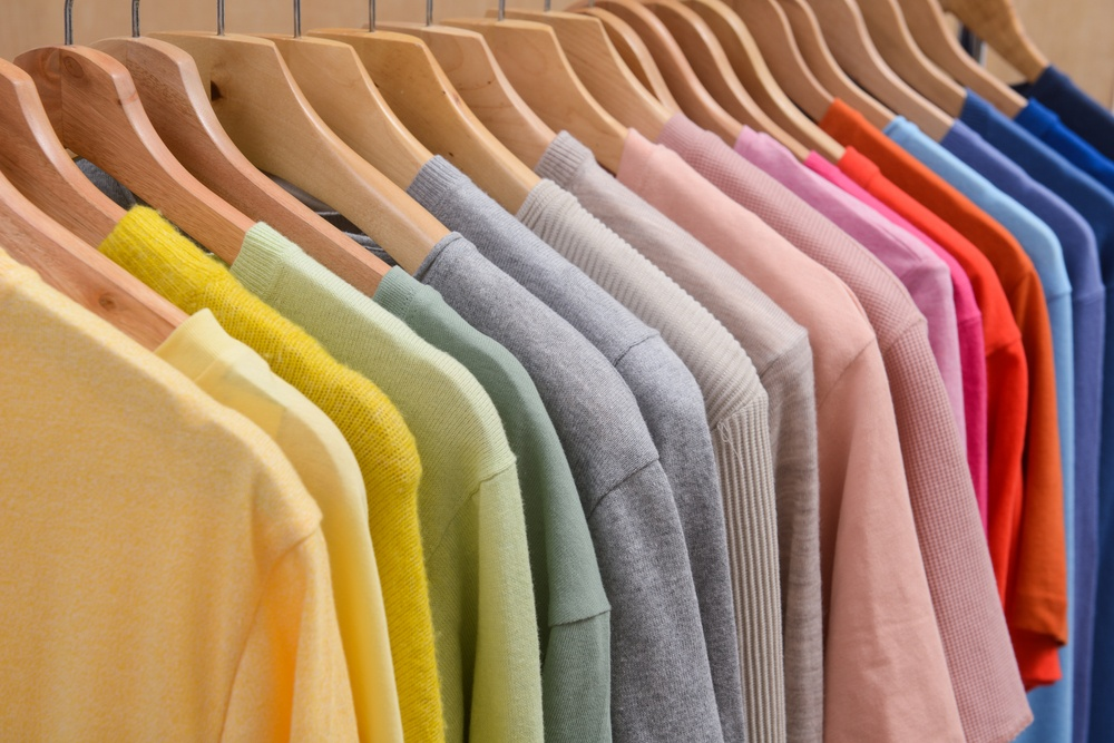 colorful t shirts on a rack representing t shirt affiliate programs