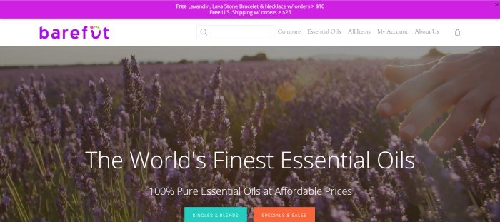 """This screenshot of the home page for Barefut shows a lavender field with a hand brushing the top of the flowers, along with the words """"The world's finest essential oils"""" in white lettering."""